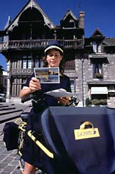 Postal carrier on bicycle