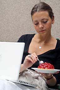 Paris fashion designer Lisa Wikander takes a break from her Macbook to enjoy a Cojean dessert.