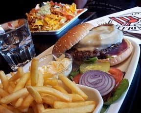 Hamburger, fries, and nachos at the Indiana Cafe, Paris.