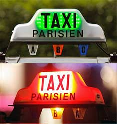 Green and red Taxi Parisien rooftop lights.